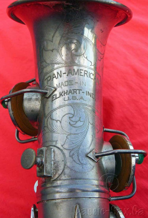 bell engraving, saxophone bell, Pan American, curved soprano, silver sax, red cloth background