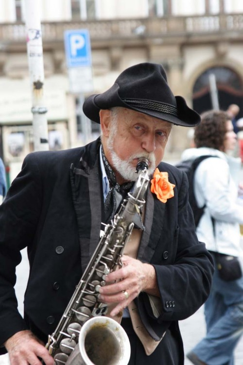 old man playing sax, busker, reduce risk of dementia by playing a musical instrument