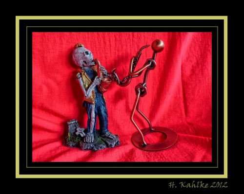 saxophone-playing figurines, skeleton, nuts & bolts
