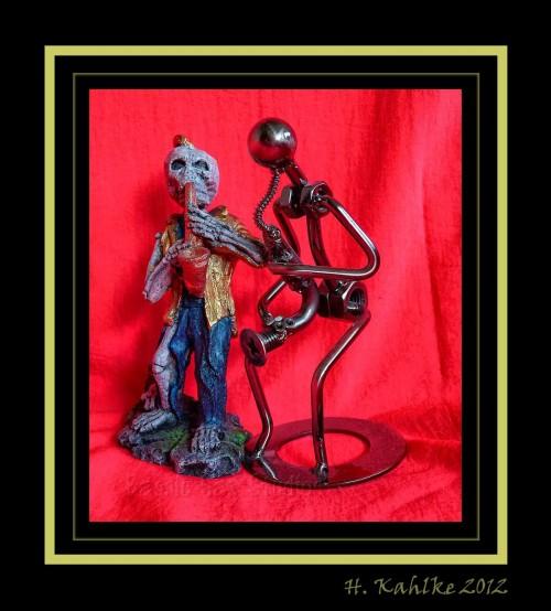 saxophone-playing figurines, skeleton, nuts & bots