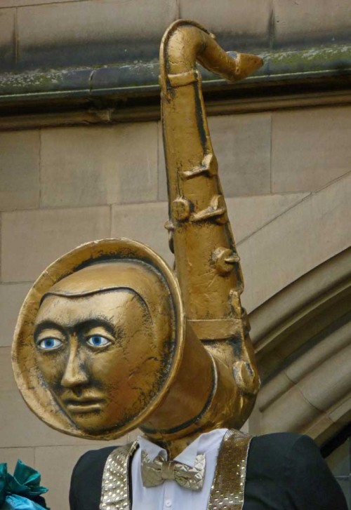 Mortal Orchestra, Bradford Lord Mayor's Parade, UK, saxophone sculpture, gold, face,