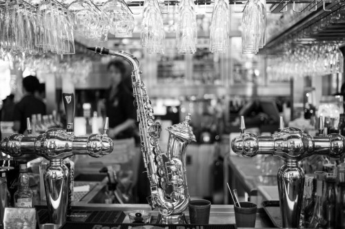 saxophone, bar, beer tap, b&w photography