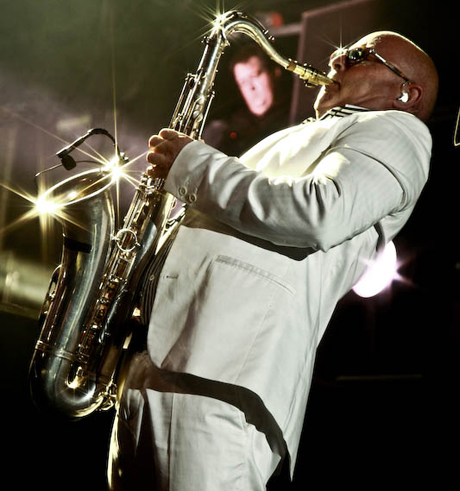 Lee Thompson, saxophone player, tenor saxophone, bald, white suite, gold saxophone, clip-on microphone,