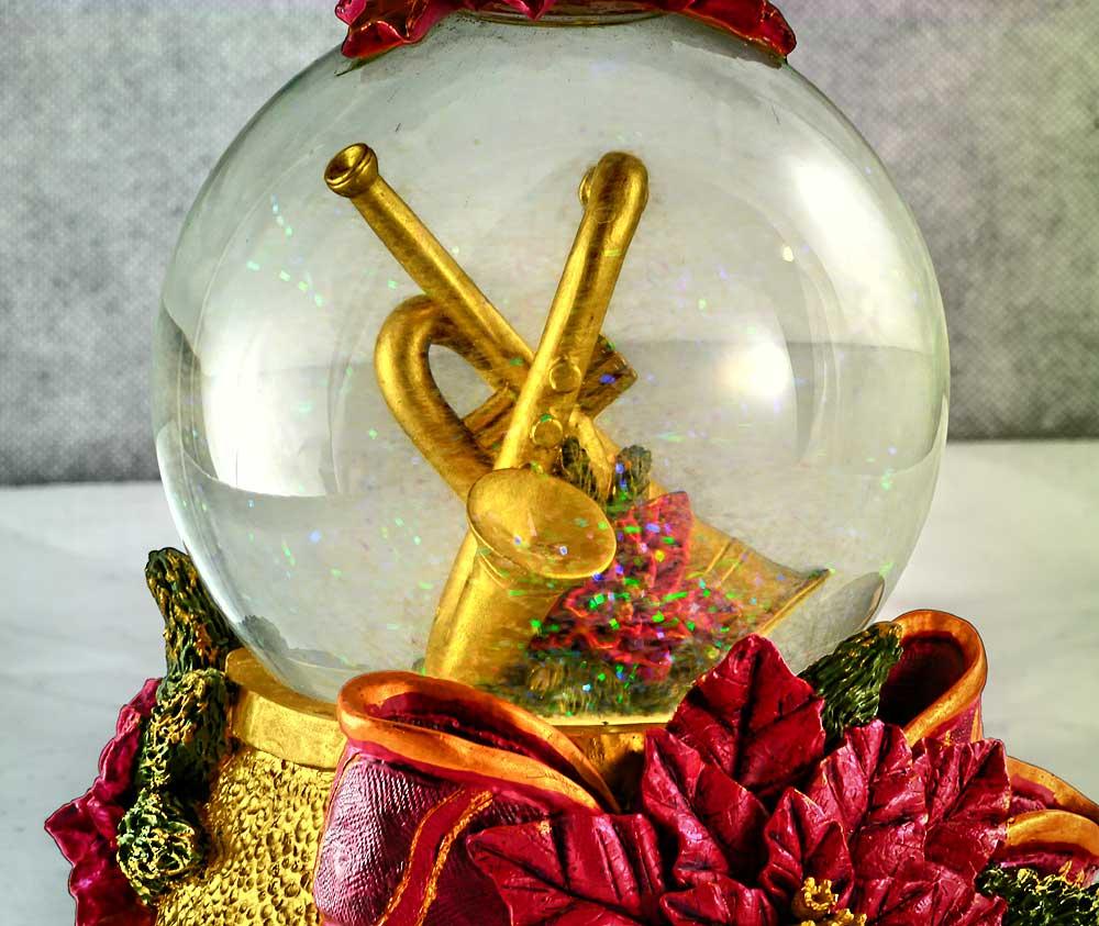 Christmas snow globe, musical snow globe, saxophone and trumpet in snow globe, poinsettia, ribbon, gold