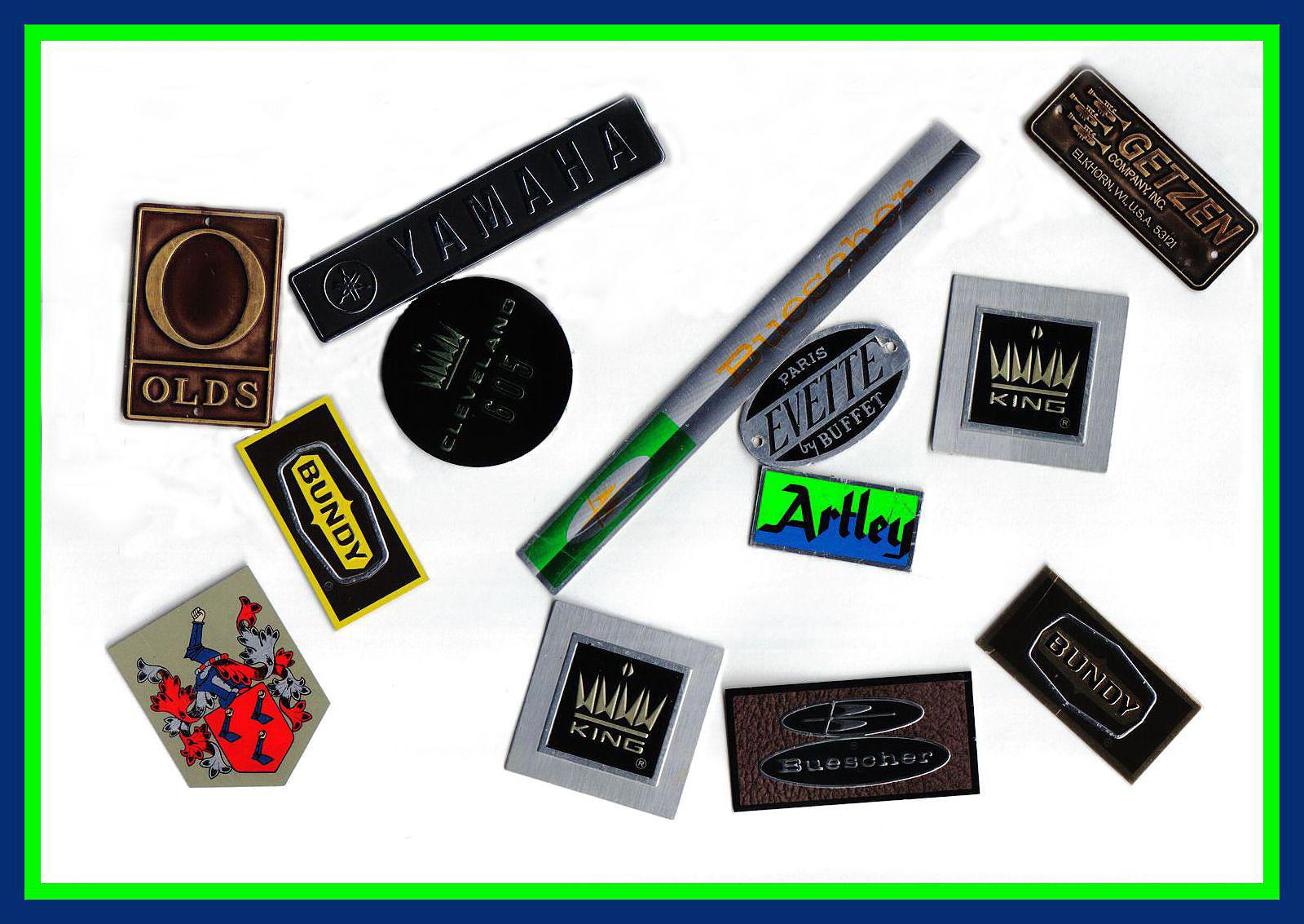 case badges, musical instrument case badges, Olds, Yamaha, Buescher, Artley, King, Evette by Buffet, Bundy, Getzen,
