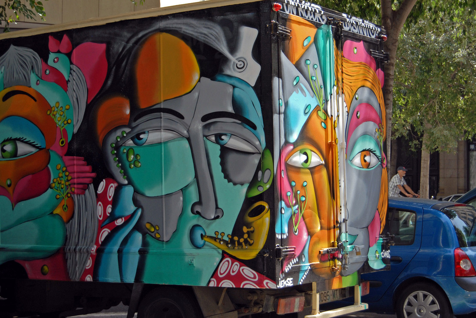 sax truck, cube van painted in graffiti style, saxophone player, Spain,