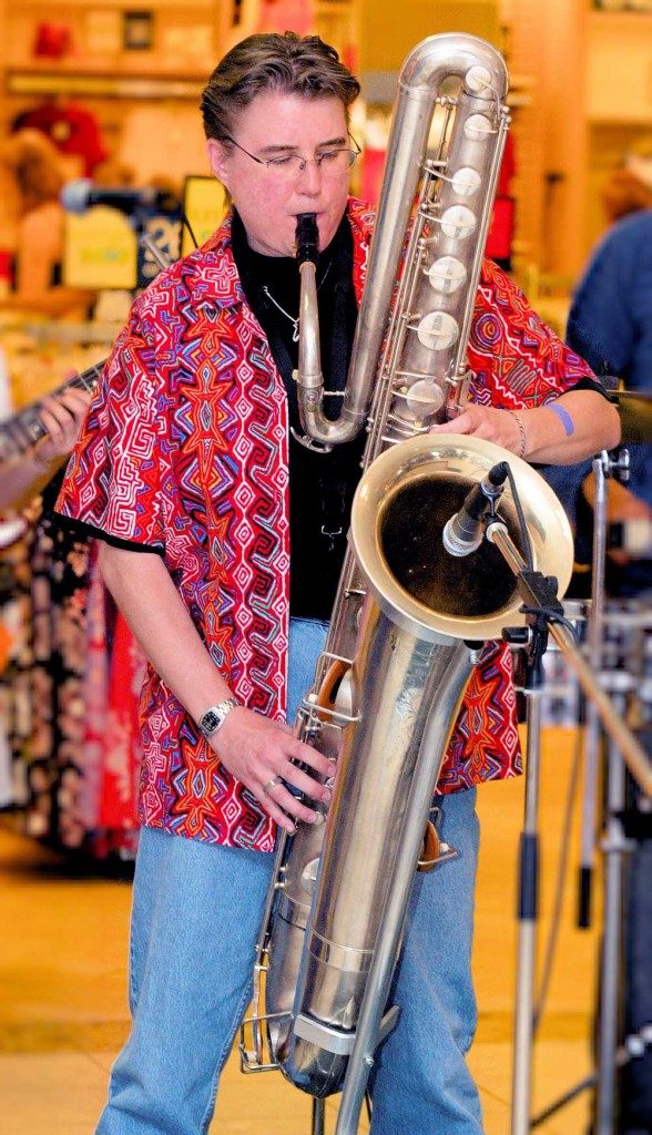 bass saxophone, bass saxophone player, female musician, microphone