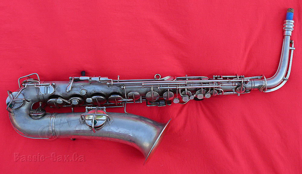 C melody saxophone, Conn sax, red cloth, silver plated horn
