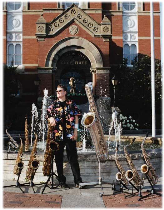 city hall, Fredericton, NB, fountain, saxophones, female saxophone player, musician, bass saxophone, soprano sax, alto sax, tenor sax, baritone sax, C melody sax