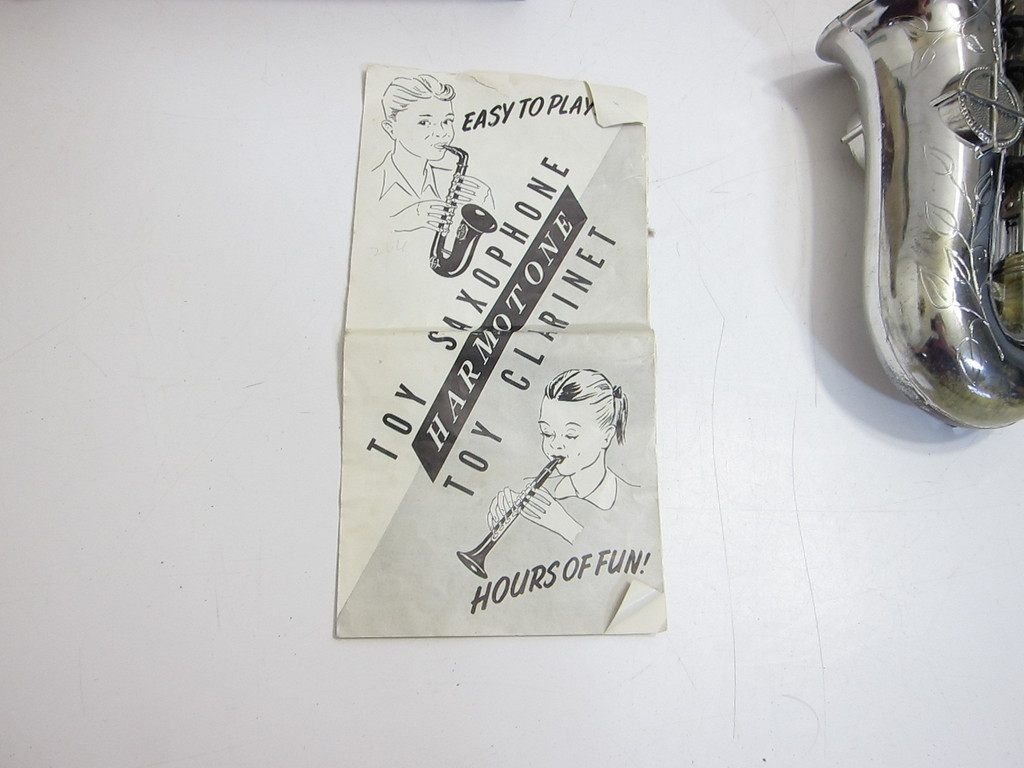 Harmotone toy sax, instruction booklet, vintage toy saxophone
