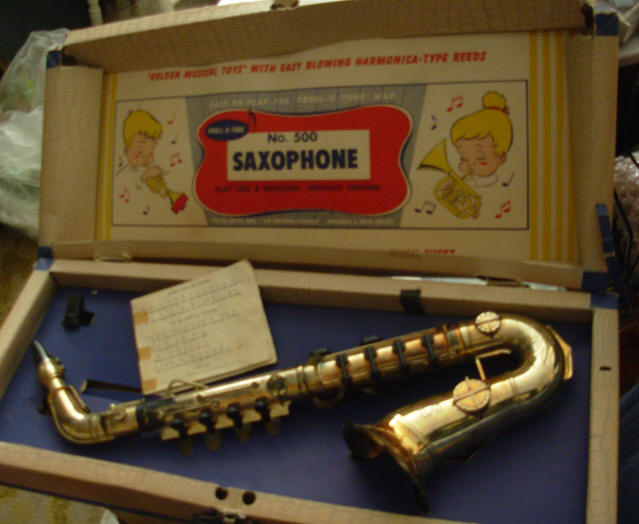 Proll-O-Tone toy sax, vintage, plastic, free reed, musical toys