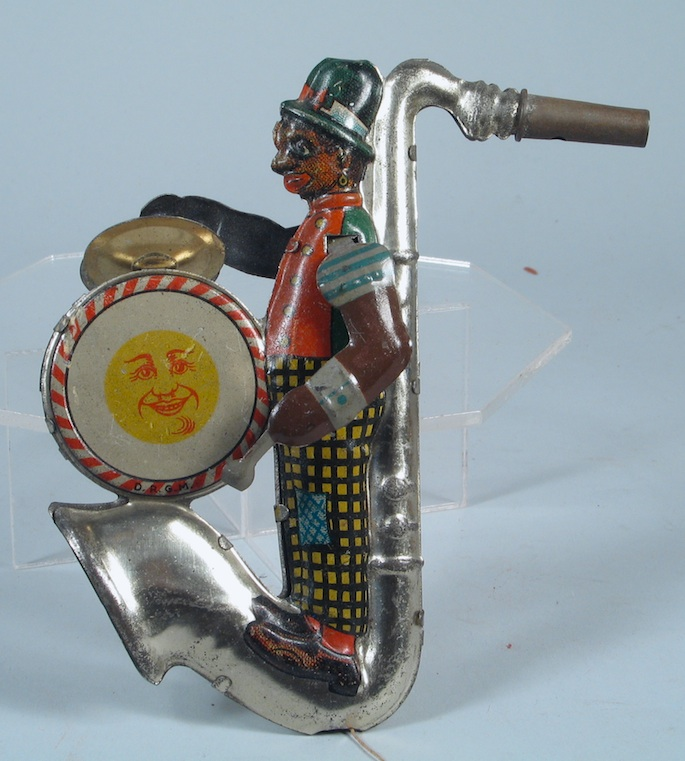 Distler, saxophone-shaped, tin whistle, penny whistle, Black man playing bass drum and cymbols, German, vintage