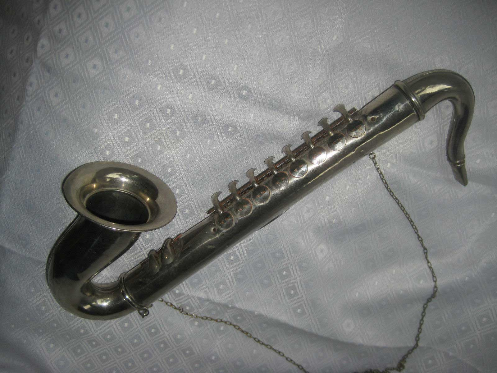 The Melody Saxophone, German-made blow accordion, vintage tin toy, vintage musical instrument